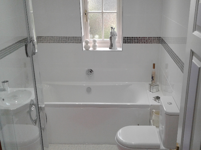 White bathroom with silver mosaic tiles