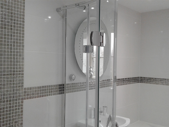 White shower room with silver mosaic tiles